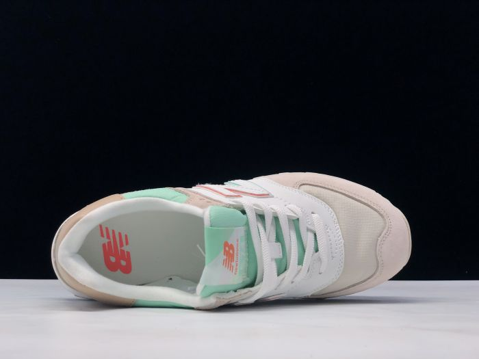 New Balance M574SCE light blue gray retro fashion sneakers couple shoes inside of