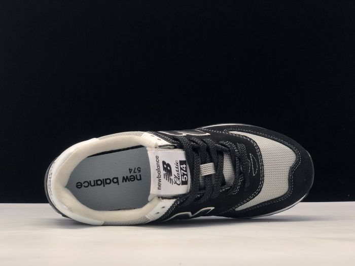 New Balance M574SSN black retro fashion sneakers couple shoes inside of