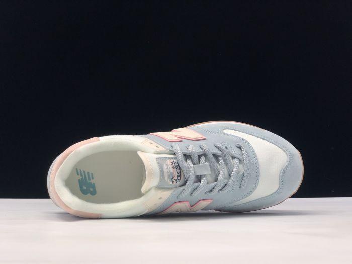 New Balance M574SUO retro fashion sneakers inside of